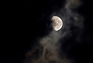 Middletown, New York - The waxing moon shines through clouds on July 7, 2014.