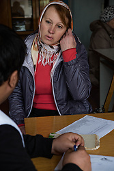 Galina,  a resident of Gorodishe near Lugansk, consults with Dr Mohsin Mehraj at an MSF mobile clinic held in the village.