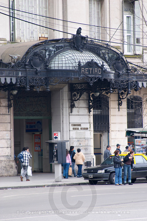 The Retiro train station FCG Mitre on the Plaza San Martin Square renamed Plaza de la Fuerza Aerea or Plaza Fuerza Retiro. Line of taxi cabs waiting,. detail of entrance with wrought iron decoration in Art Nouveau Jugend style Buenos Aires Argentina, South America