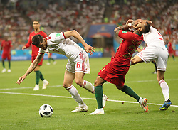 June 25, 2018 - Saransk, Russia - SAEID EZATOLAHI (L) of Iran vies with RICARDO QUARESMA (2nd R) of Portugal during the 2018 FIFA World Cup Group B match between Iran and Portugal in Saransk. The match ended in a 1-1 draw. Portugal advanced to the round of 16. (Credit Image: © Fei Maohua/Xinhua via ZUMA Wire)