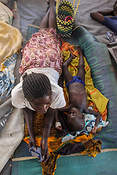 The malnutrition ward at BidiBidi provides aid to new arrivals, who have been travelling by foot for days. Many have been shot at while escaping the violence. More than 300,000 South Sudanese refugees have fled from the country's civil war into Uganda since fighting broke out in July. They mostly travel by foot for days through the bush as roads have been blocked or are too dangerous to cross. The massive influx of refugees has caused a strain in humanitarian aid due to large numbers and lack of funding. BidiBidi settlement is now the third largest in the world and holds more than 210,000 people since its opening in September.