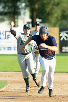 KELOWNA, BC - JULY 24:  Austen Butler #28 of the Kelowna Falcons is run down by second baseman Tanner Parker #22 of the Yakima Valley Pippins at Elks Stadium on July 24, 2019 in Kelowna, Canada. (Photo by Marissa Baecker/Shoot the Breeze)