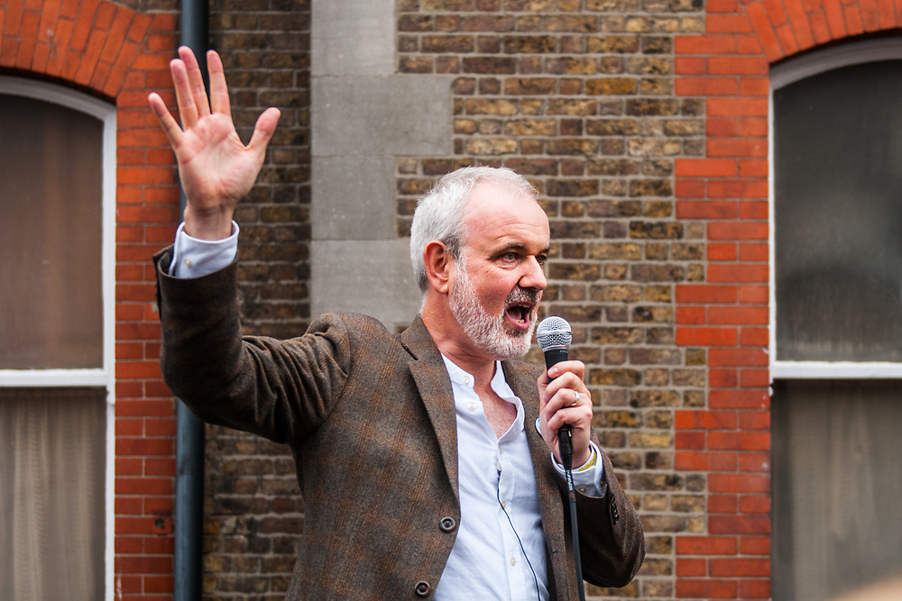 """Dublin, Ireland. 26th August, 2018. <br /> Colm O'Gorman speaks at the end of the Stand4Truth protest in front of the last laundries in Sean Macdermott Street Lower while is taking place the Holy Mass of the second of the two-days of the visit of Pope Francis in Dublin, Ireland.<br /> Pope Francis has made a two-day visit to the Republic of Ireland by celebrating a Mass at Dublin's Phoenix Park. The Argentine Pope asked forgiveness for the """"abuses in Ireland, abuses of power, conscience and sexual abuses"""" perpetrated by Church leaders. It was the first papal visit to Ireland for 39 years. During his activities many activists, victims and survivors have made protests and a silent march Garden of Remembrance towards the last Magdalene Laundry to close in Ireland.<br />  © Simone Padovani"""