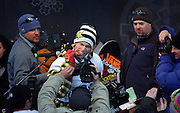 SHOT 1/26/08 4:25:09 PM - Norwegian snowboarder Andreas Wiig (center) from Oslo bites into his gold medal for photographers after winning the Snowboard Slopestyle event Saturday January 26, 2008 at Winter X Games Twelve in Aspen, Co. at Buttermilk Mountain. Wiig won the event with a score of 92.00, beating out U.S. riders Kevin Pearce (88.33) and Shaun White (83.33). It was the second year in a row Wiig has won gold in the event. The 12th annual winter action sports competition features athletes from across the globe competing for medals and prize money is skiing, snowboarding and snowmobile. Numerous events were broadcast live and seen in more than 120 countries. The event will remain in Aspen, Co. through 2010..(Photo by Marc Piscotty / WpN © 2008)