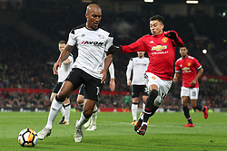 5 January 2018 - FA Cup (3rd Round) Football - Manchester United v Derby County - Andre Wisdom of Derby remains calm as Jesse Lingered of Man Utd closes in - Photo: Charlotte Wilson / Offside
