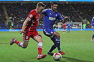Craig Noone of Cardiff crosses the ball past Kevin Bru of Ipswich.<br /> <br /> Skybet Football League Championship match, Cardiff City v Ipswich Town at the Cardiff city stadium in Cardiff, South Wales on Tuesday 21st October 2014<br /> pic by Mark Hawkins, Andrew Orchard sports photography.