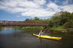 North America, United States, Washington, Bellevue, girl (age 12) kayaking in Mercer Slough Nature Park.  MR