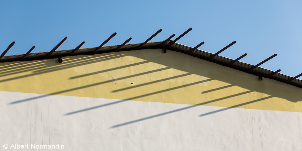 End of building with shadows and lines, Pathein