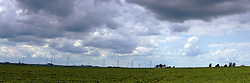 19 July 2009:  Twin Groves Wind Farm, operated by Horizon Wind Energy is east of Bloomington Normal on the Bloomington Moraine in eastern McLean County Illinois.  It is one of the largest wind farms in the world. This image was produced in part utilizing High Dynamic Range (HDR) or panoramic stitching or other computer software manipulation processes. It should not be used editorially without being listed as an illustration or with a disclaimer. It may or may not be an accurate representation of the scene as originally photographed and the finished image is the creation of the photographer.