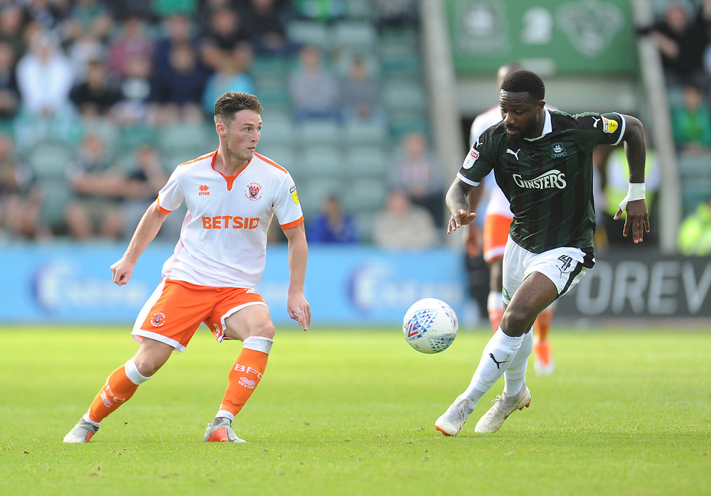 Blackpool's Jordan Thompson under pressure from Plymouth Argyle's Yann Songo'o<br /> <br /> Photographer Kevin Barnes/CameraSport<br /> <br /> The EFL Sky Bet League One - Plymouth Argyle v Blackpool - Saturday 15th September 2018 - Home Park - Plymouth<br /> <br /> World Copyright © 2018 CameraSport. All rights reserved. 43 Linden Ave. Countesthorpe. Leicester. England. LE8 5PG - Tel: +44 (0) 116 277 4147 - admin@camerasport.com - www.camerasport.com