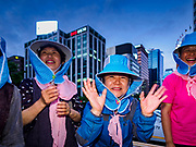 "15 JUNE 2018 - SEOUL, SOUTH KOREA:  South Korean women cheer during a rally to mark the anniversary of the signing of the June 15th North–South Joint Declaration between South Korea and North Korea. The Declaration was negotiated by late South Korean President Kim Dae-jung and North Korean leader Kim Jong-il and signed on 15 June 2000. It was a part of South Korea's ""Sunshine Policy,"" which guides the South's relationship with North Korea. This year's observance of the anniversary was bolstered by the recent thawing in relations between North Korea and South Korea and the US.    PHOTO BY JACK KURTZ"