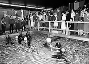 An attempt by Michael Moore of Lucan and Stephen Tisdall of Baldoyle, members of the Viking Sub-Aqua Club, to break the world underwater scuba endurance record. Started by Charles Haughey TD, at St Mary's Hospital, Baldoyle, County Dublin, the two aim to spend 100 hours underwater, and raise money for St Mary's Hospital for Physically Handicapped Children, Baldoyle.<br /> 26 December 1982
