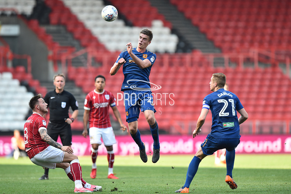 Markus Henriksen (22) of Hull City leaps up to head the ball during the EFL Sky Bet Championship match between Bristol City and Hull City at Ashton Gate, Bristol, England on 21 April 2018. Picture by Graham Hunt.
