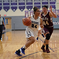 Mikayla Woody (24) of Miyamura dribbles to the basket with Samantha Moss (44) of Belen tries to defend, in Gallup on Saturday. The Lady Patriots won 63-34.