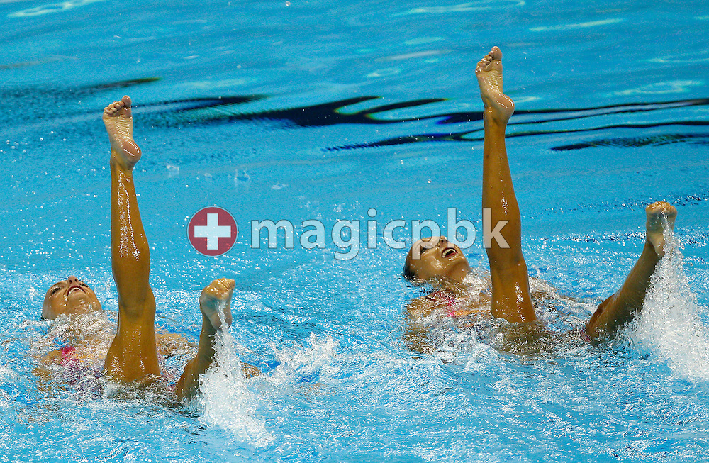 Elise Marcotte and Marie-Pier Boudreau-Gagnon (L) of Canada compete in the Synchronized (synchronised) Swimming Technical Duets Final round during the 14th FINA World Aquatics Championships at the Oriental Sports Center in Shanghai, China, Monday, July 18, 2011. (Photo by Patrick B. Kraemer / MAGICPBK)