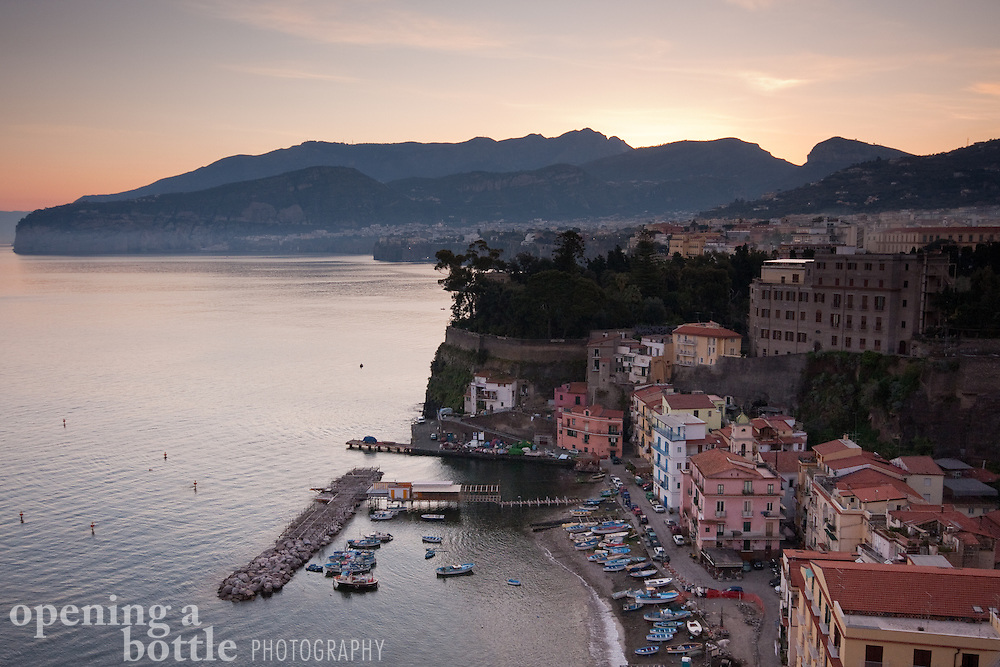 View of the skyline of Sorrento, its harbor and the Bay of Naples at dawn, Campania, Italy.