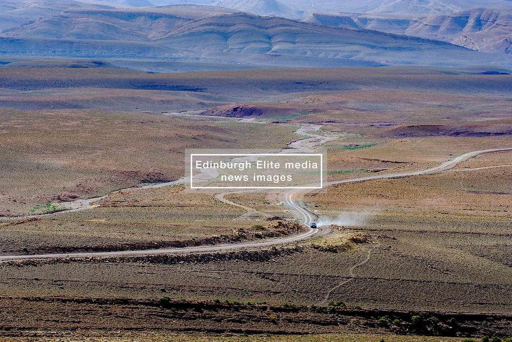 A car nakes it's way along the piste from Tamtetoucht to Msemrir, Morocco<br /> <br /> (c) Andrew Wilson | Edinburgh Elite media