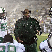 Players listen to a coach during an NCAA football game between the Marshall Thundering Herd and the Central Florida Knights at Bright House Networks Stadium on Saturday, October 8, 2011 in Orlando, Florida. (Photo/Alex Menendez)