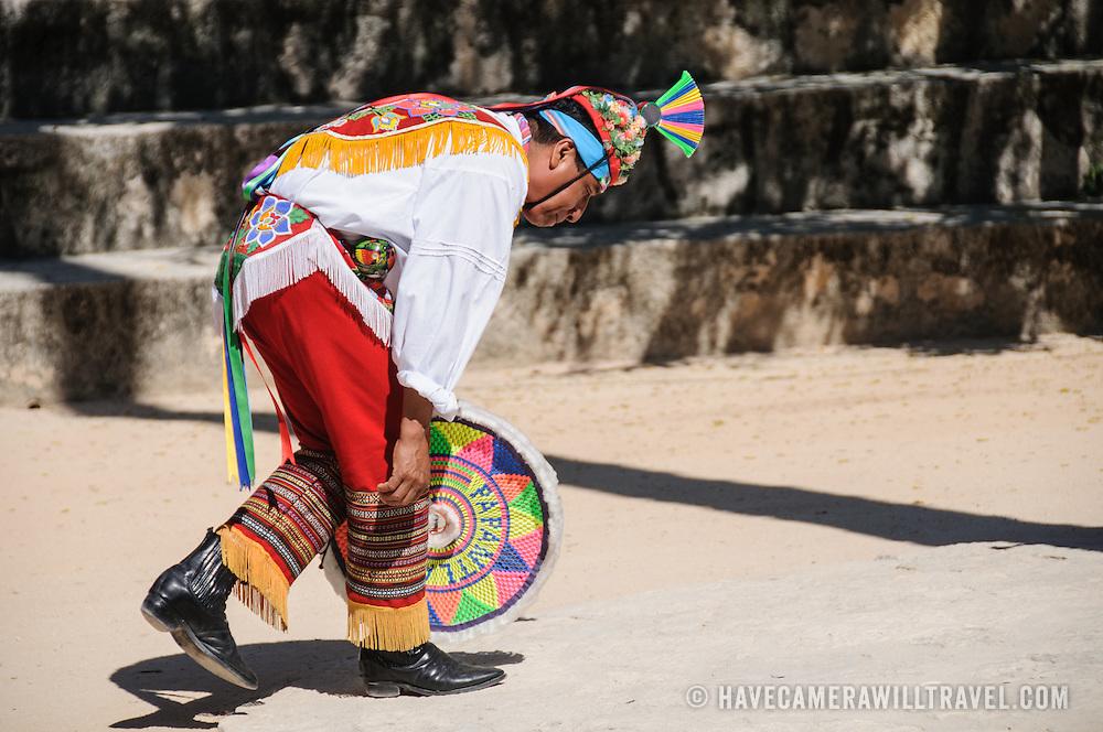 A dancer in traditional costume performing a Maya dance at Xcarat Maya theme park south of Cancun and Playa del Carmen on Mexico's Yucatana Peninsula.