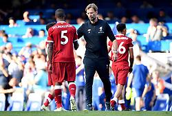 Liverpool manager Jurgen Klopp congratulates Georginio Wijnaldum for his efforts at the end of the Premier League match at Stamford Bridge, London.