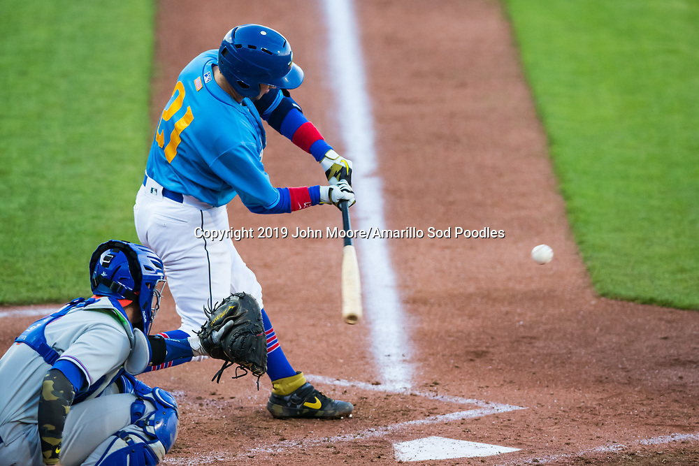 Amarillo Sod Poodles catcher Luis Torrens (21) hits the ball against the Midland RockHounds on Saturday, May 25, 2019, at HODGETOWN in Amarillo, Texas. [Photo by John Moore/Amarillo Sod Poodles]