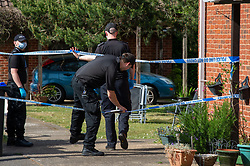 © Licensed to London News Pictures. 21/05/2020. Beaconsfield, UK. Specialist search team members enter a backyard cordoned off by police tape. Thames Valley Police were called to North Drive, Beaconsfield at around 00:01 BST on Thursday 21/05/2020 to a report of a stabbing. A man in his forties had sustained injuries consistent with stab wounds and was taken to hospital. Photo credit: Peter Manning/LNP