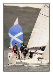 Brewin Dolphin Scottish Series 2010, Tarbert Loch Fyne - Yachting..Day one stated late but resulted in good conditions on Loch Fyne..GBR8901N , Wicked Wookie , Euan Aitken , CCC with a Saltire spinnaker in the background....