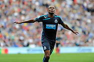 Newcastle's Loic Remy celebrates after he scores the 2nd goal. Barclays Premier League match, Cardiff city v Newcastle Utd  at the Cardiff city stadium in Cardiff, South Wales on Saturday 5th Oct 2013. pic by Andrew Orchard, Andrew Orchard sports photography,