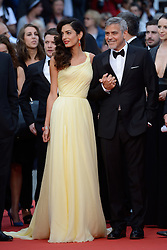 "File photo : George Clooney and his wife Amal Clooney attending the Money Monster screening at the Palais Des Festivals in Cannes, France on May 12, 2016, as part of the 69th Cannes Film Festival. Amal Clooney and her husband George are expecting twins, US media report. The babies are due in June, according to CBS's The Talk host Julie Chen. Another source close to the couple, quoted by People, said they were ""very happy"". The Clooneys' representatives have not yet commented. Photo by Aurore Marechal/ABACAPRESS.COM"