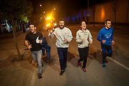 """People run on the 20th Korrika. Baltierra (Basque Country). April 1, 2017. The """"Korrika"""" is a relay course, with a wooden baton that passes from hand to hand without interruption, organised every two years in a bid to promote the basque language. The Korrika runs over 11 days and 10 nights, crossing many Basque villages and cities. This year was the 20th edition and run more than 2500 Kilometres. Some people consider it an honour to carry the baton with the symbol of the Basques, """"buying"""" kilometres to support Basque language teaching. (Gari Garaialde / Bostok Photo)"""