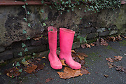 A pair of pink wellington boots aka wellies have been left outside a residential house in East Dulwich, on 12th December 2019, in south London, England.