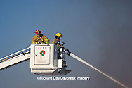 63818-02216 Firefighters extinguishing warehouse fire using aerial ladder truck, Salem, IL