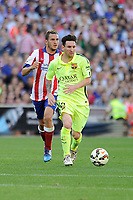 Atletico de Madrid´s Koke and FC Barcelona´s Lionel Messi during 2014-15 La Liga match between Atletico de Madrid and FC Barcelona at Vicente Calderon stadium in Madrid, Spain. May 17, 2015. (ALTERPHOTOS/Luis Fernandez)