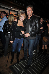 LEE CHAPMAN and LESLIE ASH at a party to celebrate the publication of 'A Matter of Life and Death' by Ronni Ancona and Alistair McGowan held at Daunt Books, 83 Marylebone High Street, London on 8th October 2009.