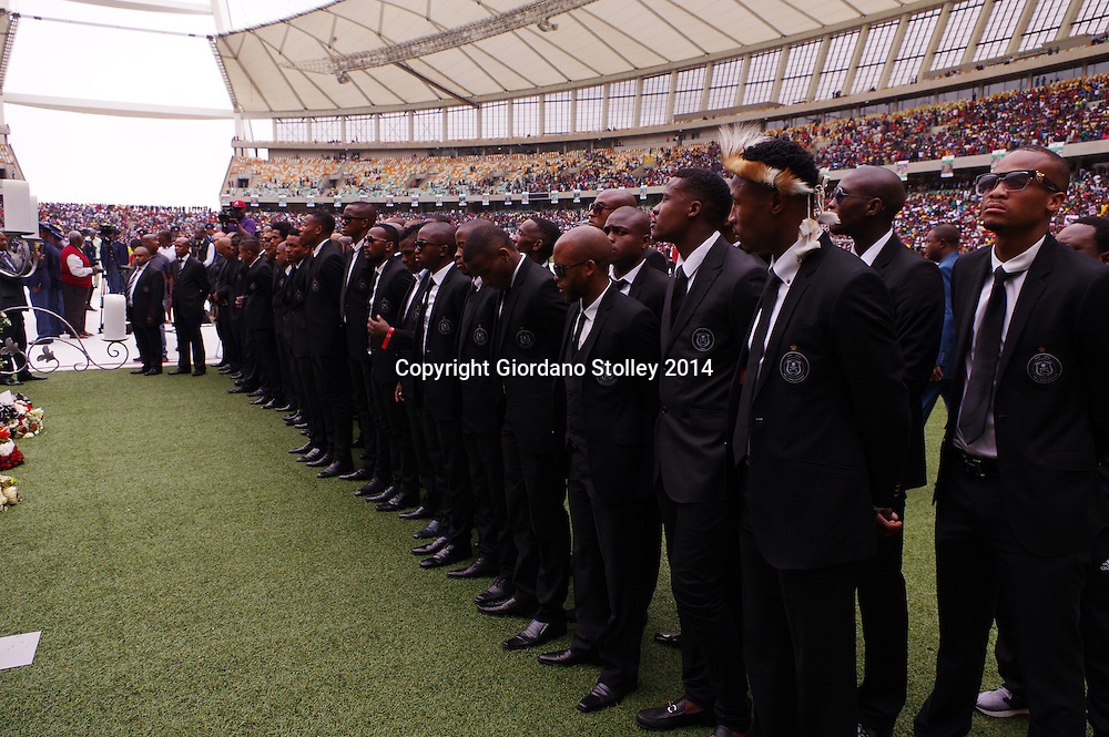 DURBAN - 1 November 2014 - Players and staff from the Orlando Pirates soccer club stand together at the funeral of their goal keeper Senzo Meyiwa in Durban's Moses Mabhida Stadium. Meyiwa who also captained the South African nationa team was gunned down by robbers a week earlier in Vosloorus where he was visiting his girlfriend. Picture: Allied Picture Press/APP