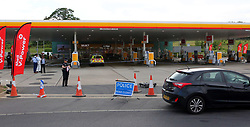 """© Licensed to UK  News in Pictures. Monday  26th June 2017 Cobham,Surrey , UK.  Police have locked down a major service station on the M25 """"Cobham Services"""" after a man was attacked with a shovel.  An ambulance and an air ambulance was sent to the scene just after 3.30pm on Monday afternoon.  The shell filling station remained closed officer whilst scene of crime officer examine a blue Ford Focus and carry out a finger tip search of the area. Police have yet to confirm if the attack has been arrestted.©UKNIP © Licensed to UK  News in Pictures. Cobham M25 Service  Murder  Friday  30th June 2017 A house has been sealed off in Portsmouth  by police investigating a seA man in his 20's from East Surrey has been arrested on suspicion of murder following an altercation at the Shell petrol station at Cobham Services on Monday.Senior investigating officer Detective Chief Inspector Jo Hayes said:""""Officers are still searching for a second suspect in connection with this incident, and I'd urge that person to make contact with us.<br /> The investigation into the serious assault at Cobham Services has now become a murder enquiry after the victim died<br /> <br /> ©UKNIP © Licensed to UK  News in Pictures.Cobham,Surrey Monday 3rd July 2017 Officers investigating an incident at Cobham Services petrol station on Monday 26 June, in which a 20-year-old man received fatal head injuries, have charged a man with murder.<br /> Simon Daniel Baker, 22, from Green Lane, Outwood near Redhill, will appear at Staines Magistrates Court later today (3 July 2017).<br /> Officers are still looking to trace second man in connection with the incident.<br /> Anyone with any information is asked to call Surrey Police on 101 (999 in an emergency) or report it online athttp://report.police.uk, quoting 45170068211. You can also report any information you may have to the independent charityCrimestoppersin complete anonymity by calling 0800 555 111.<br /> ©UKNIP"""