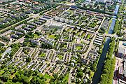 Nederland, Noord-Holland, Amsterdam, 14-06-2012; zuidelijk deel van de wijk Slotervaart met in het midden het complex van De Drie Hoven (gecombineerd verpleeghuis en verzorgingshuis, architect Herman Hertzberger). Linksboven de Cormelis Lelylaan, midden het Sierplein en de Johan Huizingalaan, rechst het water van de Slotervaart en de Plesmanlaan. .De wijk is onderdeel van de Westelijke Tuinsteden, gerealiseerd op basis van het Algemeen Uitbreidingsplan voor Amsterdam (AUP, 1935). Voorbeeld van het Nieuwe Bouwen, open bebouwing in stroken, langwerpige bouwblokken afgewisseld met groenstroken. .This residential area Slotervaart is an example of garden cities of Amsterdam-west. Constructed on the basis of the General Extension Plan for Amsterdam (AUP, 1935). Example of the New Building (het Nieuwe Bouwen), detached in strips, oblong housing blocks alternated with green areas, built in fifties and sixties of the 20th century. Nursing  and care home (high-rise, middle) has been built by architect Herman Hertzberger. luchtfoto (toeslag), aerial photo (additional fee required).foto/photo Siebe Swart
