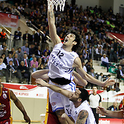 Anadolu Efes's Kerem Gonlum (F) during their Turkish Basketball Turkey Cup game 1 basketball match Galatasaray between Anadolu Efes at the BESYO Arena in Eskisehir, Turkey, Thursday, February, 2013. Photo by Aykut AKICI/TURKPIX