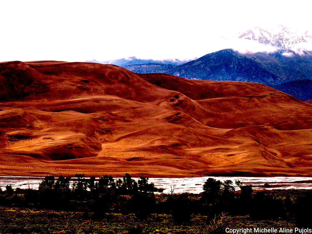 Surreal look at the Great Sand Dunes National Park, Colorado.<br /> Do you see the faces in the sand?