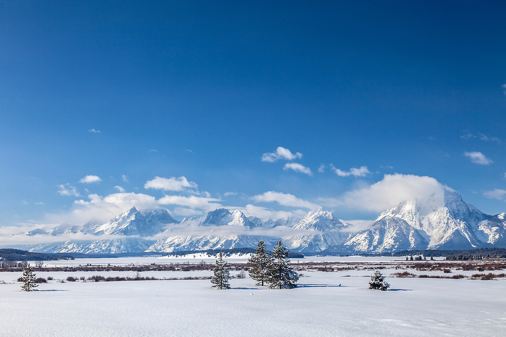 Jackson Lake openness with Grand Teton Mountain Range on cold winters morning in Wyoming.  Licensing and Open Edition Prints.