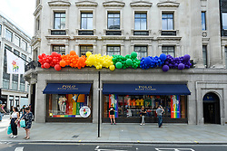© Licensed to London News Pictures. 01/07/2019. LONDON, UK.  The Polo Ralph Lauren store on Regent Street is one of many retail stores in the capital's West End whose exteriors are decorated in rainbow colours in support of Pride Month.  Pride is an annual celebration of the LGBT+ community and culminates in the LGBT+ parade in the UK, with thousands of people travelling the route either by foot or on floats.  Photo credit: Stephen Chung/LNP