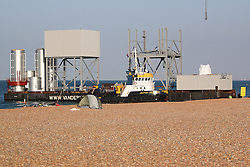 © Licensed to London News Pictures. 11/06/2015. Brighton, UK. Sections that will form the base of the I360 tower, manufactured by the Dutch Rotterdam based manufacturer Hollandia Steelworks, arrive by barge in Brighton as the construction of the 488ft (149m) begins. Photo credit : Hugo Michiels/LNP
