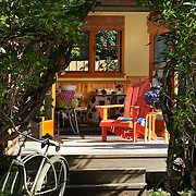 Front entry of beach house, showing lifestyle and walkway with shrubbery.