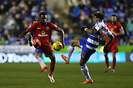 Hope Akpan of Blackburn Rovers and Danny Williams of Reading compete for the ball. Skybet football league championship match, Reading  v Blackburn Rovers at The Madejski Stadium  in Reading, Berkshire on Sunday 20th December 2015.<br /> pic by John Patrick Fletcher, Andrew Orchard sports photography.