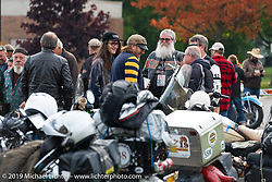 CCC event promoter Jason Sims chats with at group or riders before boarding the SS Badger Lake Michigan ferry during the Cross Country Chase motorcycle endurance run from Sault Sainte Marie, MI to Key West, FL (for vintage bikes from 1930-1948). Stage 2 from Ludington, MI to Milwaukee, WI, USA. Saturday, September 7, 2019. Photography ©2019 Michael Lichter.