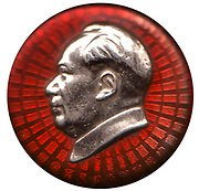 """'Mao zhuxi xiangzhang' is the name give to a type of pin badge displaying an image of Mao Zedong that was ubiquitous in China during the early period of the Cultural Revolution from 1966 to 1971. Chairman Mao badges were, together with the """"little red book"""", one of the most visible and iconic manifestations of the Cult of Mao. It is estimated that several billion Chairman Mao badges were produced during the period of the Cultural Revolution."""