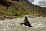 We hire a yak from Rahmat Ali (met in Baikara Wakhi summer settlement) in order to cross the deep and fast running Tash-kopruk river (aka Bai Kara river). The last days trek into Pakistan, on our way to Irshad Uween pass (4925m).<br /> <br /> Adventure through the Afghan Pamir mountains, among the Afghan Kyrgyz and into Pakistan's Karakoram mountains. July/August 2005. Afghanistan / Pakistan.