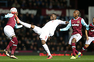 Christian Benteke of Liverpool in action. The Emirates FA cup, 4th round replay match, West Ham Utd v Liverpool at the Boleyn Ground, Upton Park  in London on Tuesday 9th February 2016.<br /> pic by John Patrick Fletcher, Andrew Orchard sports photography.
