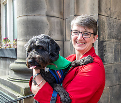Pictured: Maggie Chapman was joined by Dougal the rescue dog for the important vote. Dougal had his own views on electors who may not vote Green<br /><br />Maggie Chapman, number one on the Scottish Greens list of EU candidates was up early to welcome voters at Portobello Town Hall.<br /><br />Ger Harley | EEm 23 May 2019