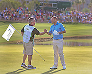 """22 JAN 15  Winning caddie Scot Gneiser and Bill Haas on the 18th green at the conclusion of Sunday""""s Final Round at The Humana Challenge at PGA West, in LaQuinta, California.(photo credit : kenneth e. dennis/kendennisphoto.com)"""